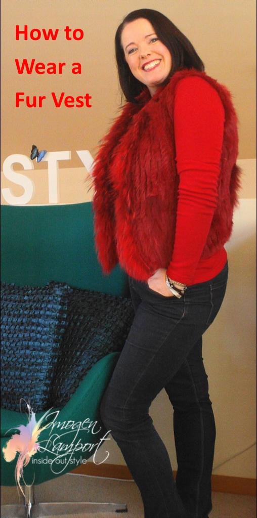 Wearing a longer red top under my fur vest to lengthen it