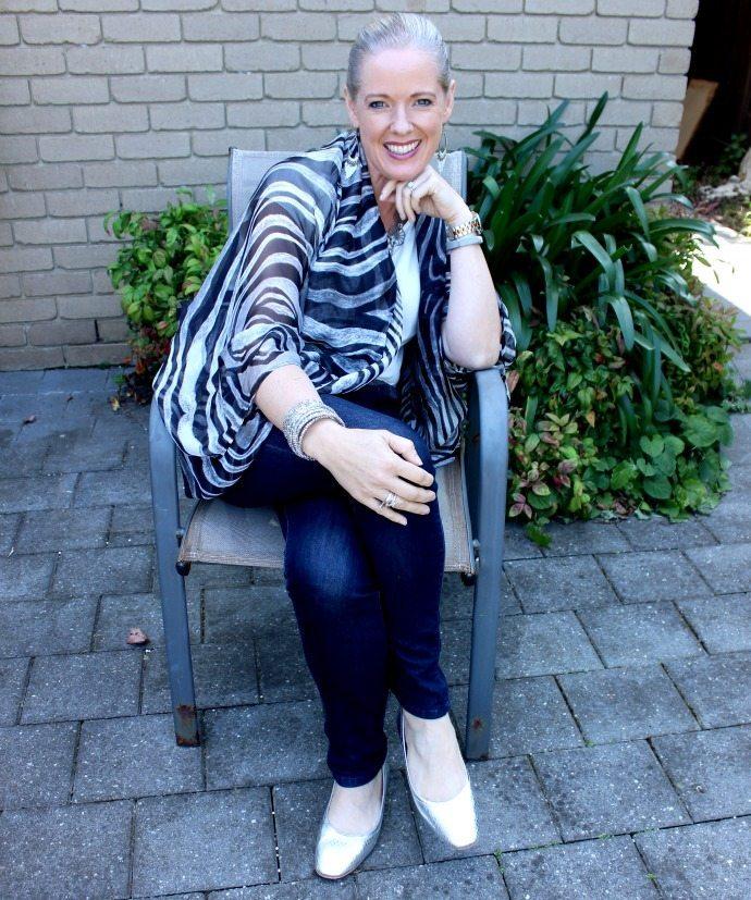 Silver Scarletto ballet flats and a zebra kimono