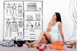 woman sitting in front of line drawing of wardrobe