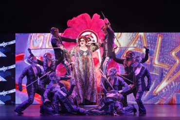 Casey Donovan as Killer Queen in We Will Rock You