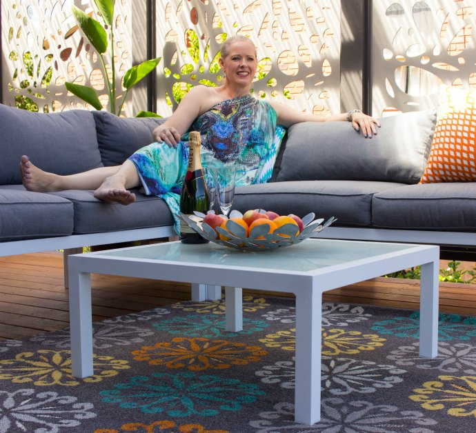 Add a pop of colour using rugs and cushions to your outdoor living space