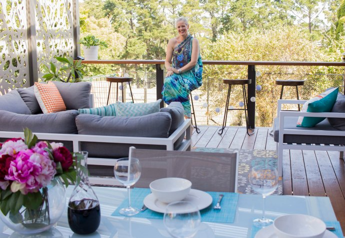 Make an outdoor room feel comfortable with rugs and soft furnishings