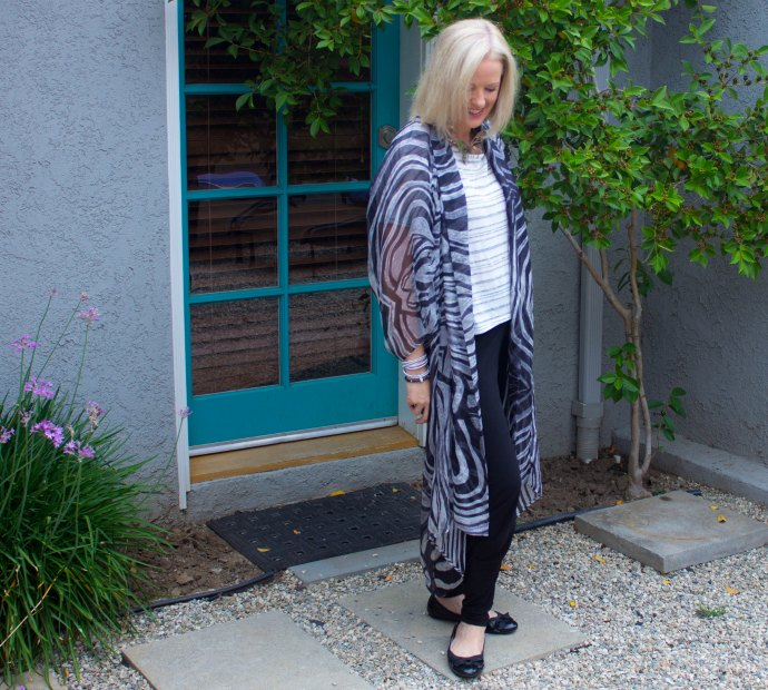 Kimonos are great to add a light layer of warmth when required plus they fold up really small and don't add weight to your packing - travel packing tips